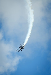 Acrobatic plane in smoke action during airshow