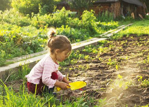 Cute little girl having fun at countryside - 73287487