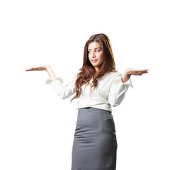 attractive businesswoman presenting something on the palm of her