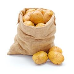 White potatoes in burlap sack