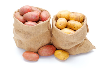 Red and white potatoes in burlap sack