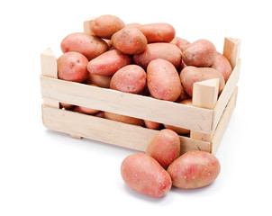 Red potatoes in wooden crate