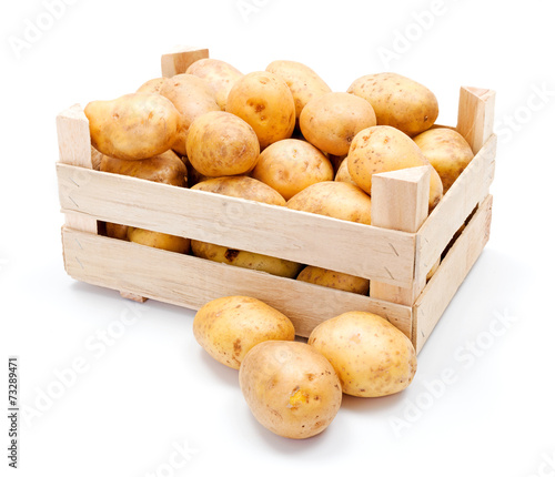 Papiers peints Legume White potatoes in wooden crate