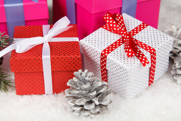 Christmas gift boxes in snow