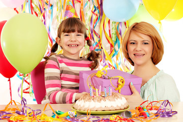 happy daughter and mother with gift birthday party