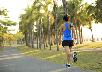 woman runner running at tropical park