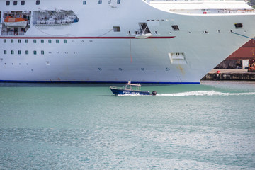 Port Police Cruising Past Cruise Ship