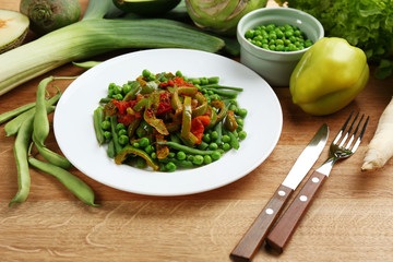 Healthy salad with peas, asparagus and pepper, close-up