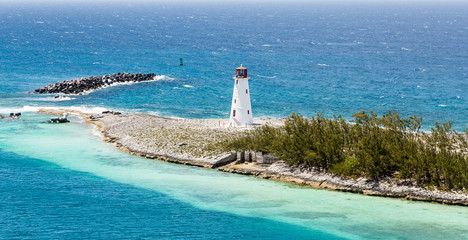 Small White Lighthouse on Strip of Land in Caribbean