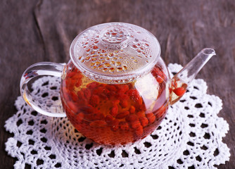 Goji berries drink in glass teapot