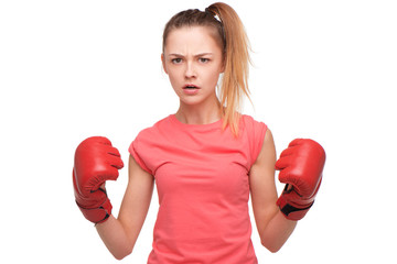 Angry teen girl with boxing gloves