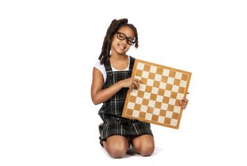 smart girl in glasses with a chessboard