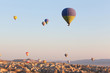 Multicolored balloons in flying in sky, sunrise time - 73292402