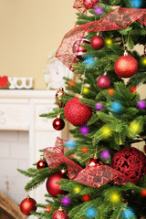 Decorated Christmas tree in room closeup