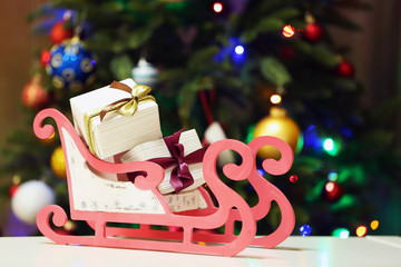 Decorative sledge with gifts on Christmas tree lights