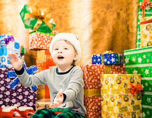 little boy catching gift box at holiday background