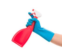 Hand holds spray bottle.
