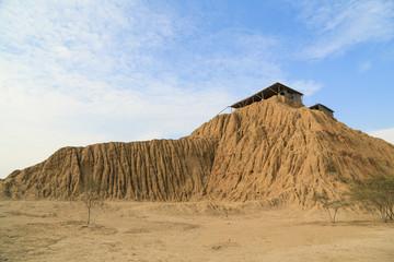 Ruins of a pre-inca site with adobe pyramids