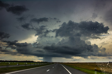 Storm clouds over the road.