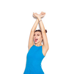 Happy woman enjoying and raising her hands up