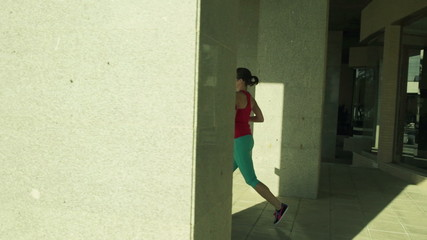 Beautiful woman jogging in the city