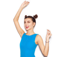 Young woman saluting and winking and showing tongue