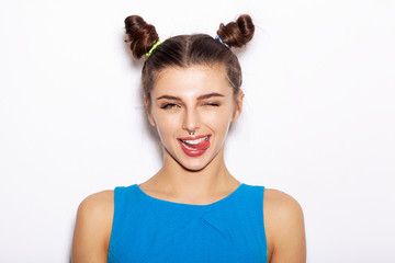 Young woman  winking and showing tongue