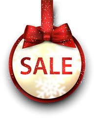 Sale label with red gift bow.