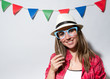 Leinwanddruck Bild - Woman in a Photo Booth party holding