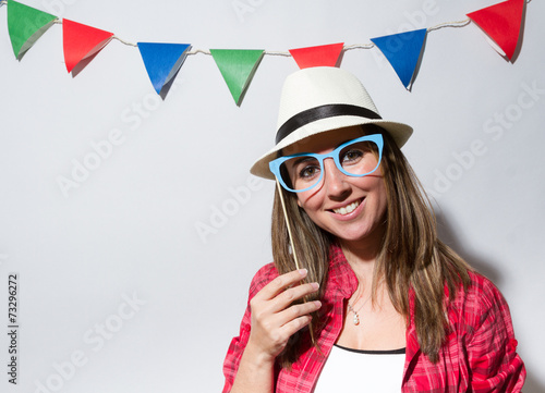 Leinwanddruck Bild Woman in a Photo Booth party holding