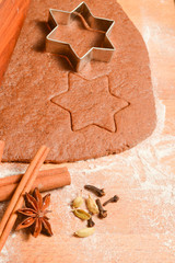 Baking Christmas Gingerbread cookies. Scene depicts rolled dough