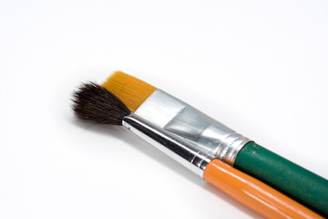 Two artistic paint brushes on white background