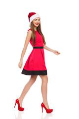 Smiling santa girl walking