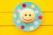 canvas print picture - Krapfen mit Smiley Gesicht
