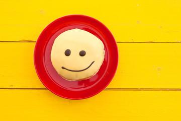 Krapfen mit Smiley Gesicht