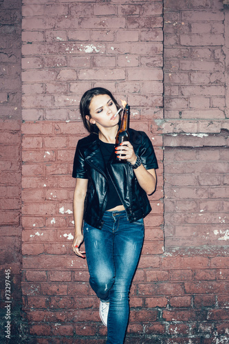 Woman hooligan lighting up a cigarette