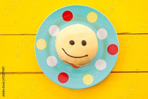 canvas print picture Krapfen mit Smiley Gesicht