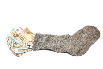 Деньги в носке на белом фоне