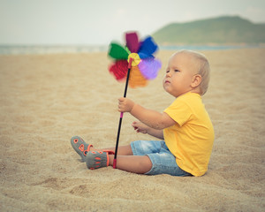 Baby with toy windmill
