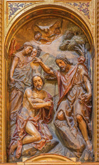 Seville - polychrome carved relief of the Baptism of Christ