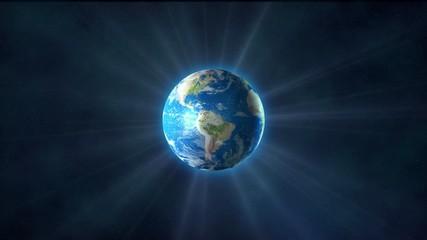 Planet Earth shines rays