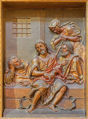 Seville - carved relief of St. John the Baptist in prison