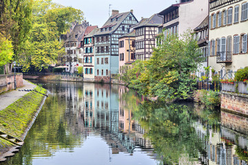 Colorful traditional houses reflecting in river in Strasbourg