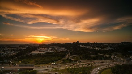 Sunset Time Lapse over a factory and motorway