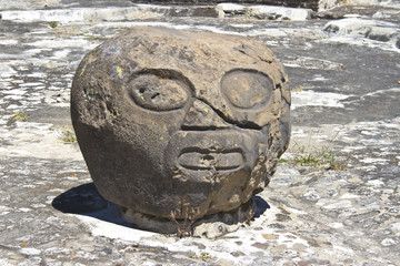 Basalt head sculpture in Cholula, Mexico