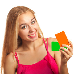 young woman holding gift cards