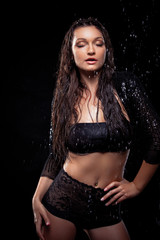 Portrait of young sensuality beautiful woman under the stream of