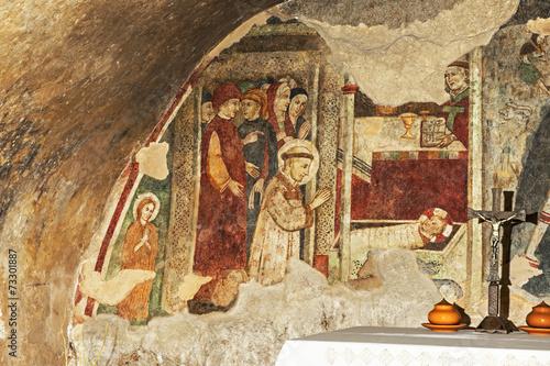 Leinwanddruck Bild Franz von Assisi verehrt das Jesuskind, Fresko in Greccio
