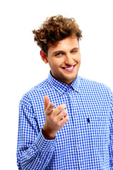 Smiling man pointing at you over white background