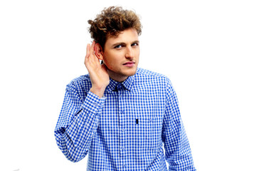 Portrait of young casual man which overhears conversation